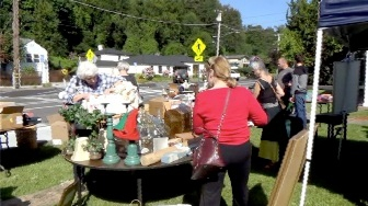 People shopping at a yard sale